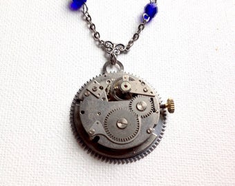 Sapphire blue crystal and silver steampunk watch movement