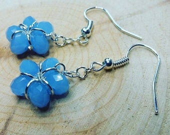 Handmade earrings in silver and opaque blue.