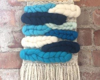 Handwoven wall hanging with roving in blue tones