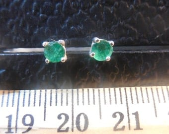 Oiled natural emerald stud earrings availible in 14karat white gold 14k yellow gold and .925 sterling silver heavy weight pushbacks