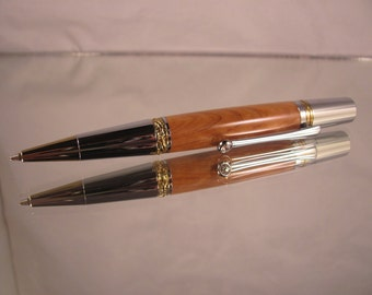 Majestic squire. Gold Titanium and chrome pen. Olive wood.