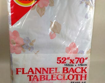 "Vintage Vinyl Tablecloth With Flannel Back With A Flower Motif/52"" By 70""/New In package (O)"