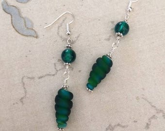 Green-blue lampwork glass earrings with silver accents