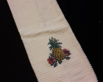 Towel has embroidered dishes