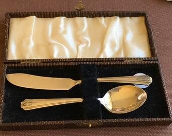 Silver plate spoon & knife in case
