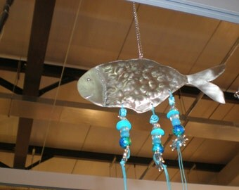 hanging ornamental fish from metal and beads