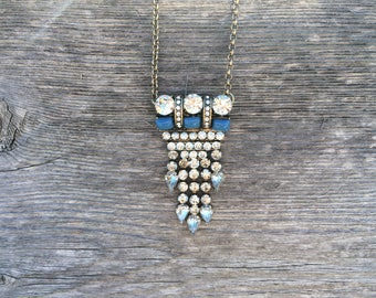 silver and teal pendant necklace with crystal fringe