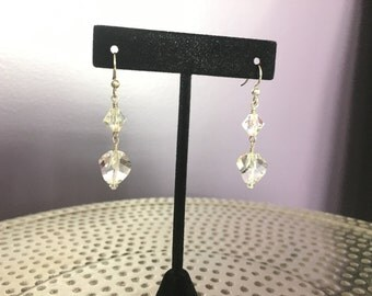 Handmade Clear Swarovski crystal drop earrings. Sterling silver french hook.