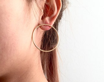 Oversized circle stud earrings