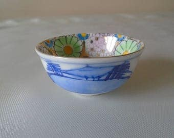 tiny hand painted bowl blue and white with hand painted interior