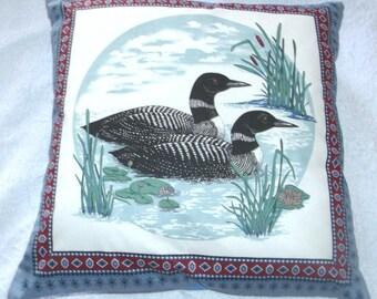 Loons on a lake cushion