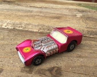 Vintage matchbox car series 19 road dragster in pink dated 1970