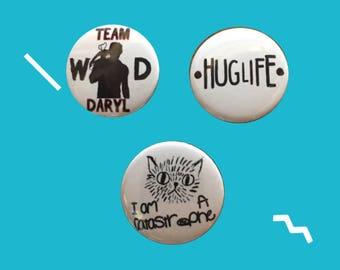 "Set of 3 Pin Badges: ""I am a Catastrophe"", ""Huglife"" & ""Team Daryl"""