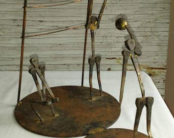 Folk Art Piece using Antique Cut Nails to Create Human Like Figures Playing Volleyball.  Nicely welded.  Sturdy. A Great Gift Idea. Classy.