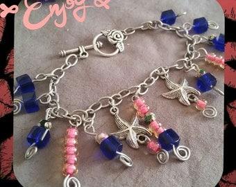Charm Bracelet stars,flower,and beads