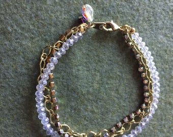 "8 1/2"" Rhinestone and gold three row bracelet"