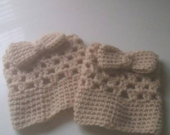 Brown boot cuffs with bow