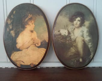 Pair of oval Victorian decoupaged prints on wood plaques Age of Innocence A Boy with a Cat