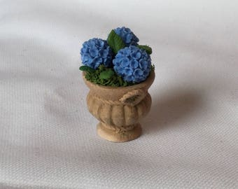 Planter with blue hydrangeas