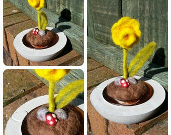 Needle felted daffodil 'growing' from a concrete base with heart motif