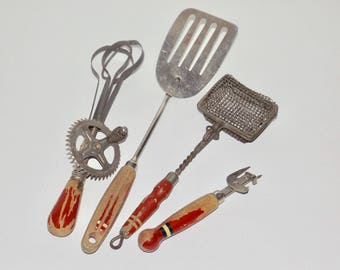 Red wood handle kitchen utensils,set of 4,red chipped paint handles,A & J egg beater,slotted spatula,bottle opener,mesh strainer,wire basket