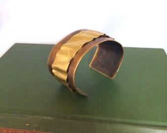 Brass ribbon on copper cuff