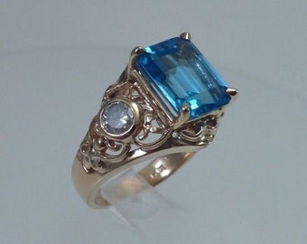 14K Yellow Gold 3 ct. Blue Topaz with 2 side diamonds Ring, 6.4 grams, Size 5.75