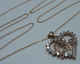 """2 Gram 10K Yellow Gold Heart Shaped Pendant with Cubic Zirconias and 20"""" Chain"""