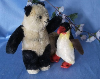 Vintage Panda bear with little friend,