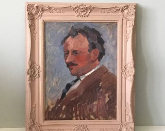 French gentleman vintage portrait painting with ornate painted frame.