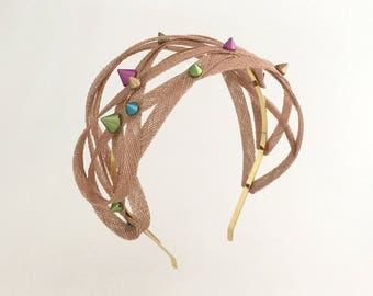 Beige tangled headband with spikes