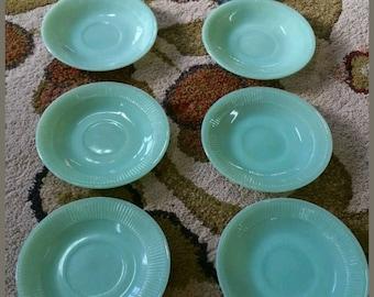 Vintage Jadite fireking saucers. Set of 8