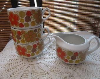 Pontessa Young Range Ironstone Set of Three Cup and A Milk Jug Orange Floral Design  (1960s)