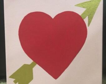 Heart with arrow sign
