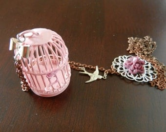 Pink bird cage necklace