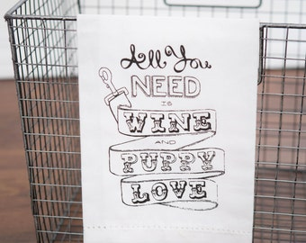 All you need is wine and puppy love Tea Towel