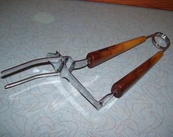 Vintage Bakelite fork tongs.