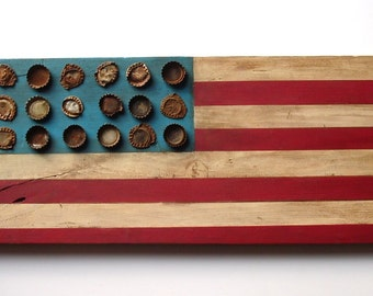 "Original, ooak hand painted rustic wood folk art American flag with rusty antique and vintage metal bottlecaps-26"" long x 9"" wide x 1"" deep"