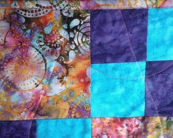 Purple, teal,hand made quilt.