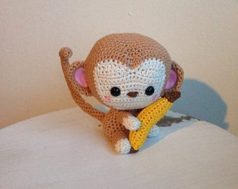 Very cute crochet monkey Kiko, with banana.