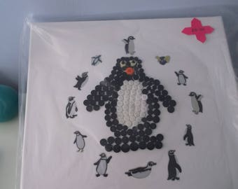 a penguin picture made out of buttons