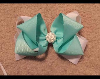 White and teal pearl center bow