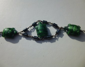 Hand Twisted Sterling Silver and glass turtle Bracelet