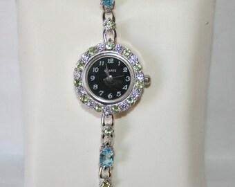 Topaz set wristwatch + peridot in Sterling Silver 925/1000. Weight: 26,80 grams.