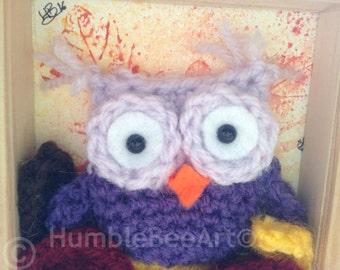 Crochet owl in frame