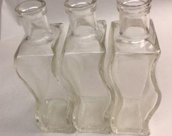 Vintage Nesting Glass bottles