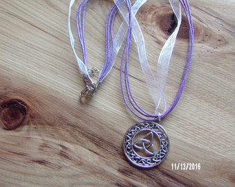 N306 Metal Celtic Symbol on a  cord and nylon necklace