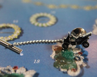 Sarah Coventry Tie Tack - Model T, year 1970's.  Silver in color with black. Great Condition, No Box