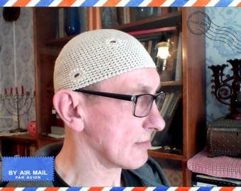 Men's summer hat from a linen thread with the amusing darned holes
