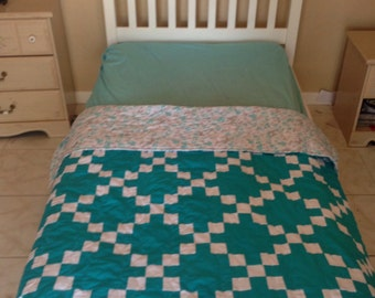 Dark teal and white single Irish chain throw